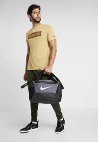 Nike Performance - Sports bag - flint grey/black/white - 1