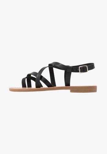 T-bar sandals - black