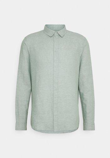 Skjorta - mottled light green