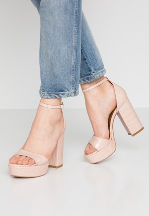 High heeled sandals - cocco nude