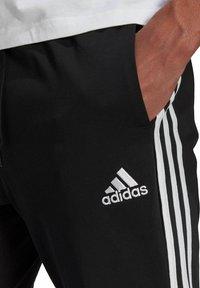 adidas Performance - Tracksuit bottoms - schwarz - 1