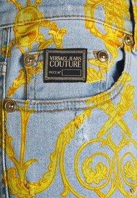 Versace Jeans Couture - HARRY - Slim fit jeans - light-blue denim - 6
