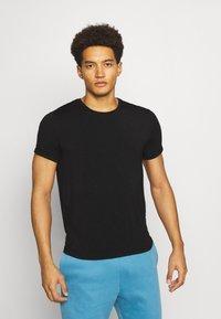 Curare Yogawear - MEN - T-shirt basic - black - 0