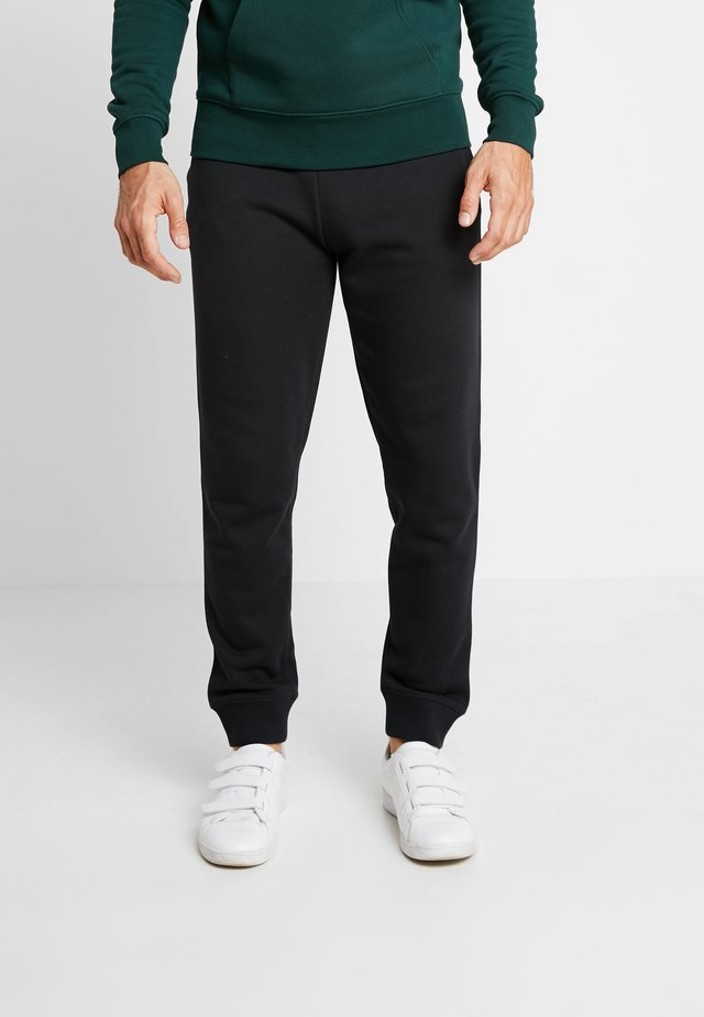 THE ORIGINAL PANT - Tracksuit bottoms - black