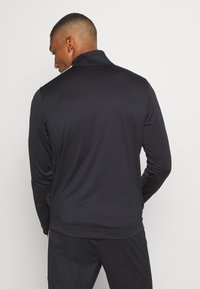 Under Armour - EMEA TRACK SUIT - Trainingsanzug - black - 2