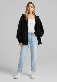 Bershka - OVERSIZE - Zip-up sweatshirt - black - 1