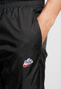 Nike Sportswear - PANT PATCH - Træningsbukser - black - 3