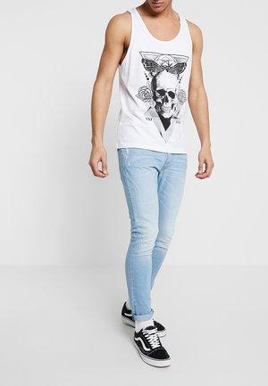 Slim fit jeans - bleached denim