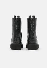 Furla - RITA MID BOOT ZIP - Platform ankle boots - nero - 3