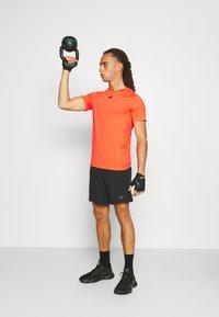 4F - Men's training shorts - Sports shorts - black - 1