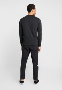 The North Face - TECH PANT - Spodnie treningowe - black - 2