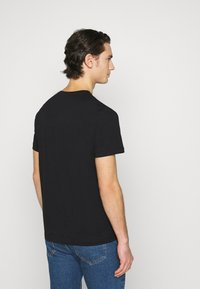 Tommy Jeans - LAYERED GRAPHIC TEE  - Print T-shirt - black