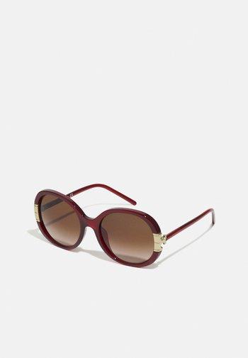 Solglasögon - milky bordeaux