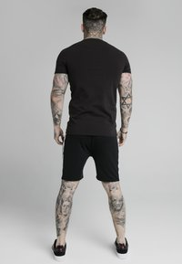 SIKSILK - RAGLAN TECH TEE - Print T-shirt - black - 2