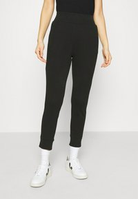 CALANDO - Tracksuit bottoms - black - 0