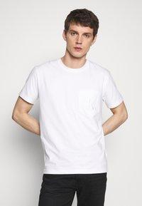 Calvin Klein Jeans - TONAL POCKET MONOGRAM TEE - Print T-shirt - bright white - 0