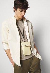 Filippa K - ROLL NECK TEE - Basic T-shirt - desert taupe - 3