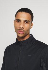 Nike Golf - HYPERSHIELD RAPID ADAPT 2-IN-1 - Waterproof jacket - black/dark smoke grey - 3