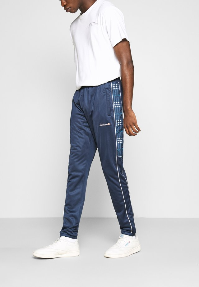 ARCOLE - Tracksuit bottoms - navy
