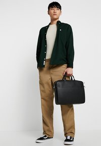 Calvin Klein - Taška na laptop - black - 1
