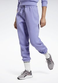 Reebok - MODERN SAFARI PANTS - Tracksuit bottoms - purple - 0