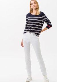 BRAX - STYLE CAROLA - Slim fit jeans - white - 1