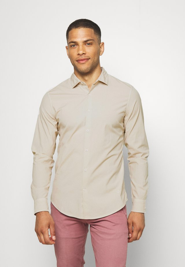 SUSTAINABLE ALPHA SPREAD COLLAR - Shirt - taupe