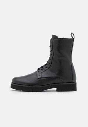 CHALLENGER - Platform ankle boots - schwarz