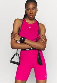 Nike Performance - TANK ALL OVER  - T-shirt sportiva - fireberry/white - 3