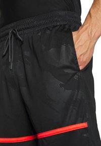 Jordan - JUMPMAN CAMO SHORT - Sports shorts - black/infrared - 3