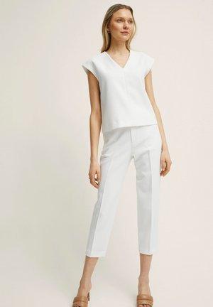 BONNIE - Trousers - white