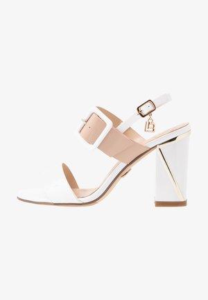High heeled sandals - white/skin