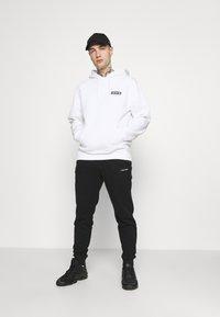 Calvin Klein - SMALL LOGO - Verryttelyhousut - black - 1