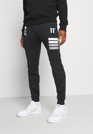 NANO REFLECTIVE STRIPE TRACK PANTS - Tracksuit bottoms - black