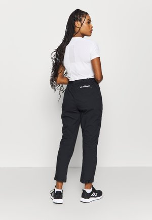 HIKEREL PANTS - Stoffhose - black