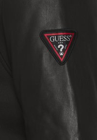 Guess - TECHNICAL HOODIE BOM - Faux leather jacket - jet black - 6
