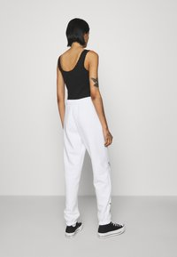 NEW girl ORDER - BUTTERFLY JOGGERS - Tracksuit bottoms - white - 2