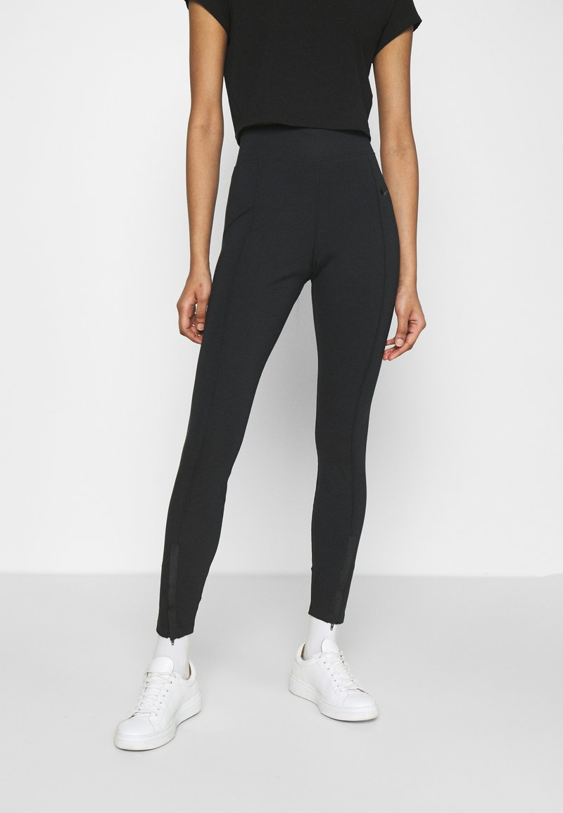 Nike Sportswear - LEGASEE  - Leggings - Trousers - black