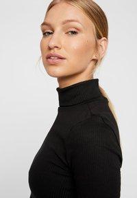 Vero Moda - ROLLKRAGEN - Top sdlouhým rukávem - black - 3