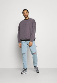 Karl Kani - RINSE PANTS - Relaxed fit jeans - light blue - 1