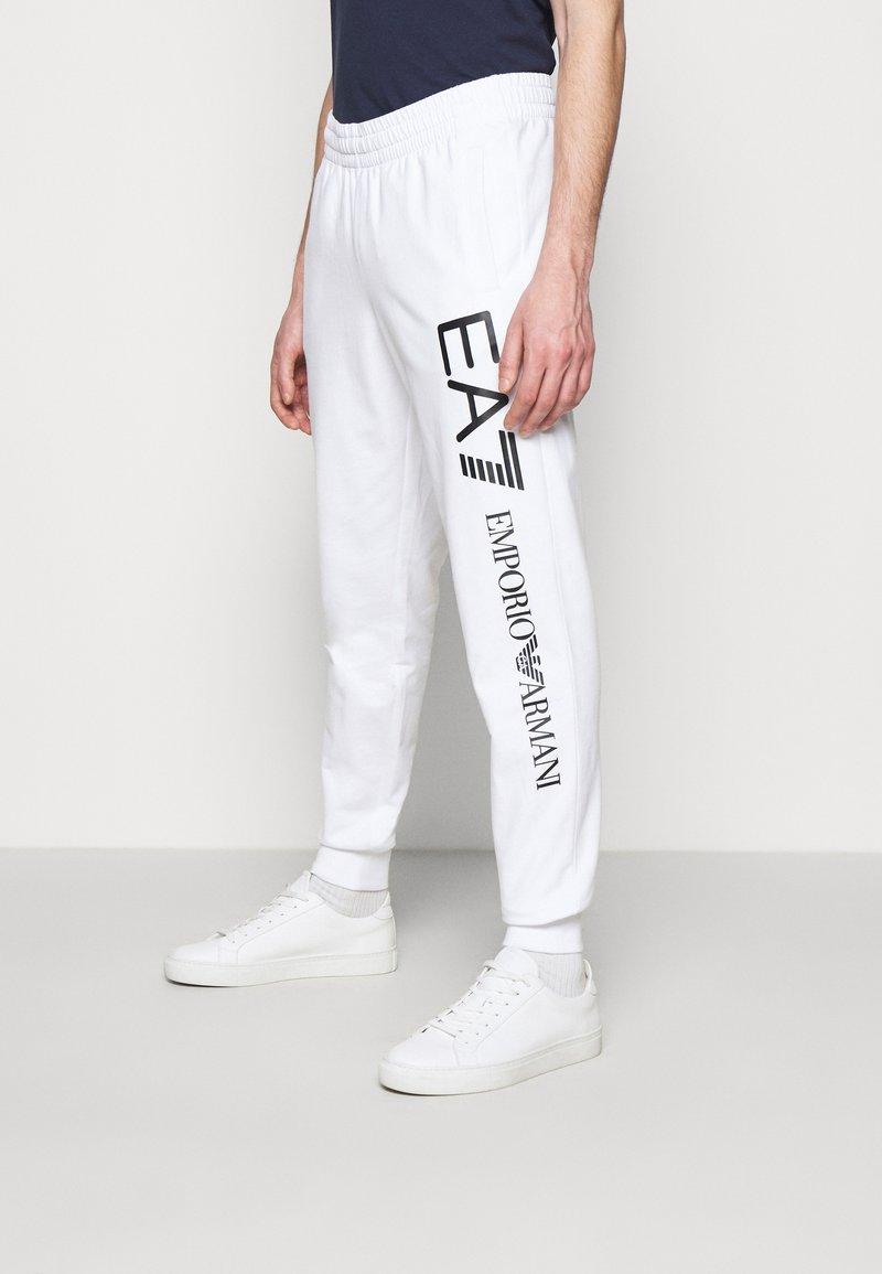 EA7 Emporio Armani - Tracksuit bottoms - white/black