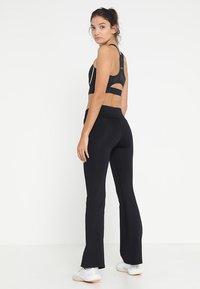 Casall - JAZZPANTS - Spodnie treningowe - black - 2