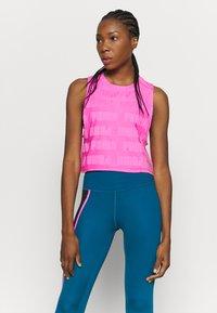 Puma - TRAIN FIRST MILE XTREME TANK - Sports shirt - luminous pink - 0