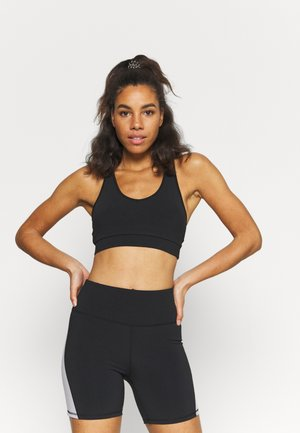 V NECK CUT OUT CROP - Light support sports bra - black