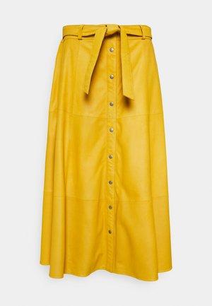 SKIRT - Kožená sukně - yellow