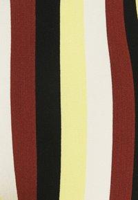 Stieglitz - BINDI FLARED - Trousers - chai - 7
