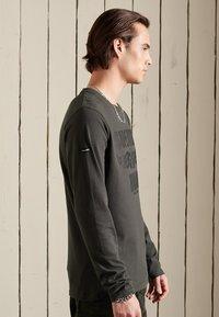 Superdry - Long sleeved top - vintage black - 2