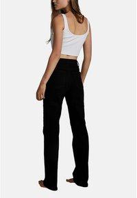 Cotton On - HIGH STRETCH - Straight leg jeans - black - 5