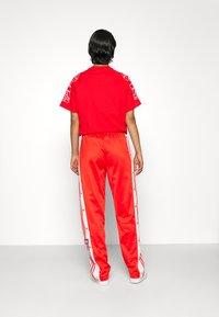 adidas Originals - ADIBREAK - Pantalones deportivos - red - 3
