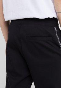 HUGO - DRAPANI - Pantalon de survêtement - black - 3